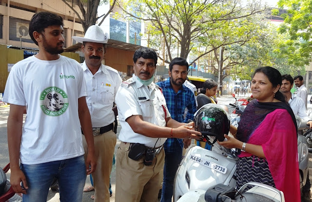 Traffic Police Giving away the helmets