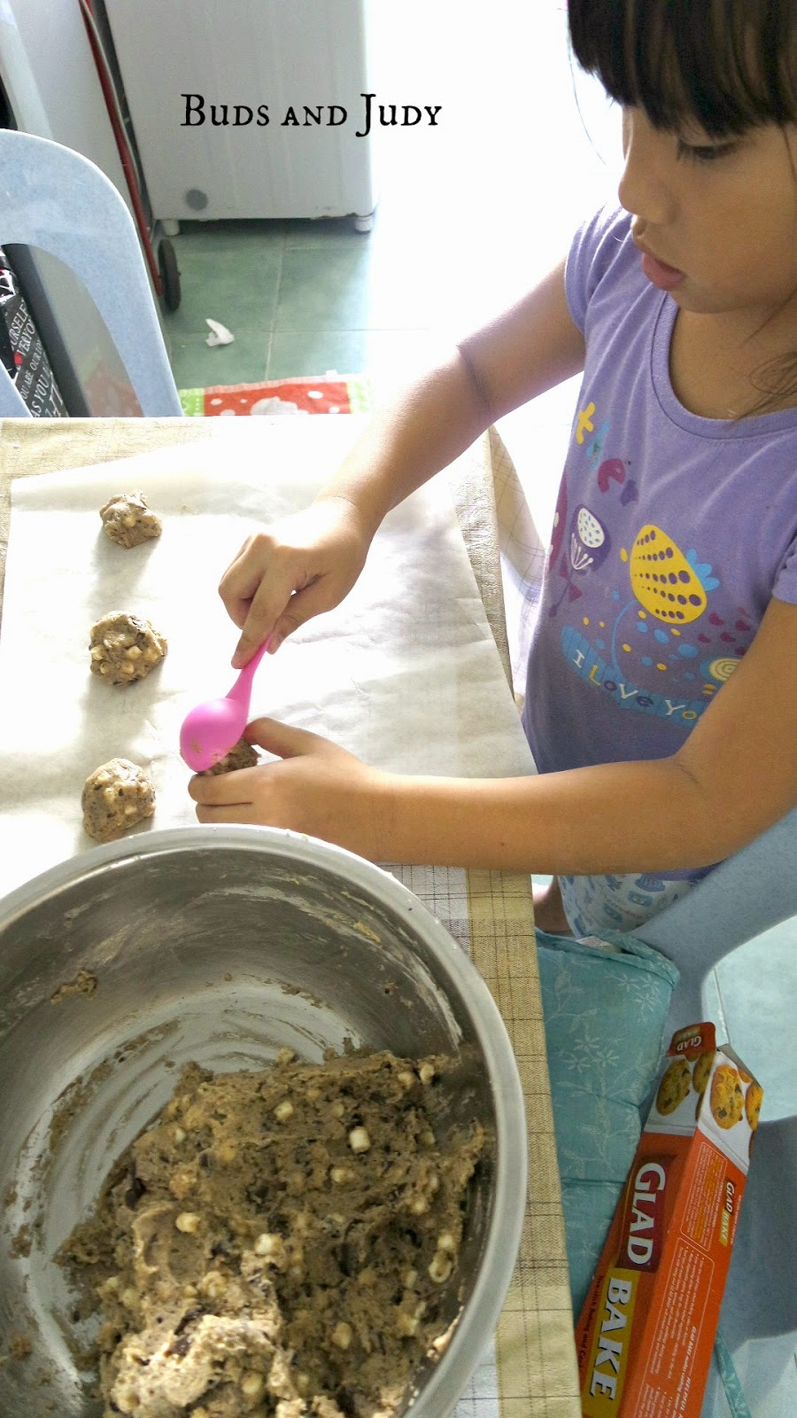 How to make S'mores Cookies. Oreo S'mores Chocolate Chip Cookies. Little Girl  scooping cookie dough