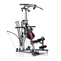 Bowflex Xtreme 2 SE Home Gym, with Lat Tower with angled lat bar, leg extension, abdominal crunch harness, 4-position lower pulley squat station. Patented Power Rods. Offers over 70 exercises