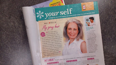 Photo of Gray haired girl in magazine discussing her decision to let her hair go naturally gray