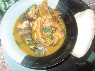 Nigerian white soup served with pounded yam