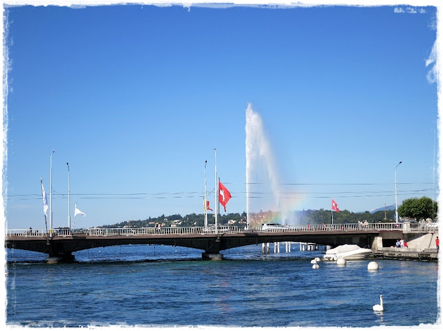 Geneva, Switzerland's Pont du Mont Blanc and famous water jet in the background (see the rainbow in the spray?).