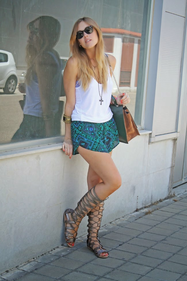 White Sando Top paired with Shorts and Gladiator Sandals