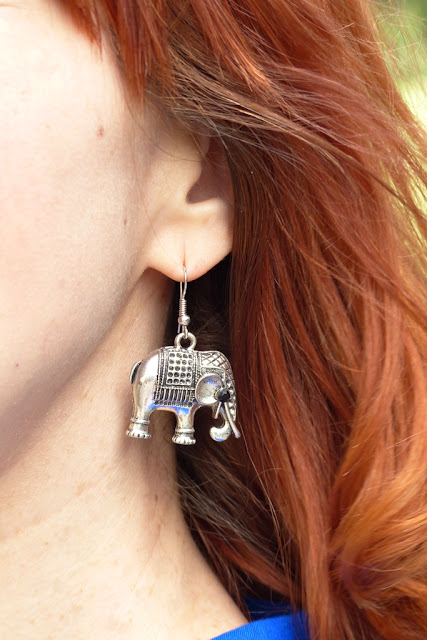 White metal elephant earrings