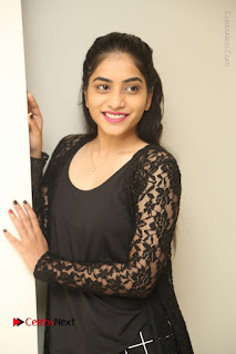 Actress Punarnavi Bhupalam Stills in Black Dress at Pittagoda Press Meet  0039.JPG