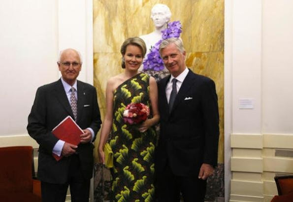 Queen Mathilde of Belgium wore a printed dress from Dries Van Noten SS 2018 collection, and she wore Natan pumps and carried Natan clutch