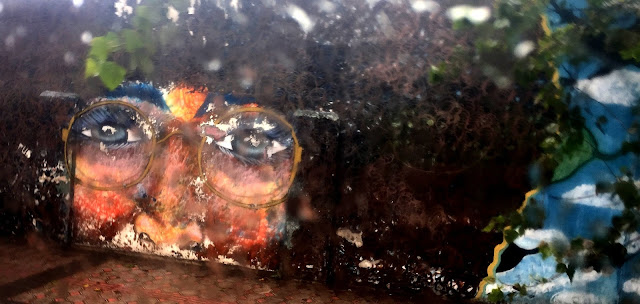view through a rainy bus window