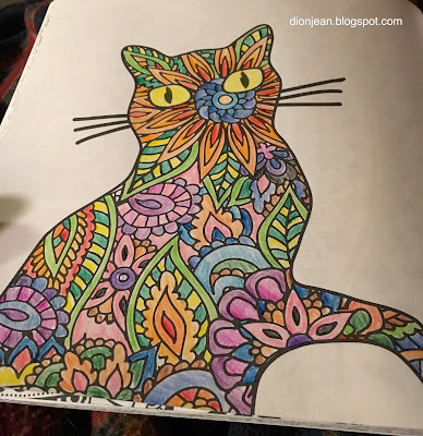 Completed page from a cat coloring book