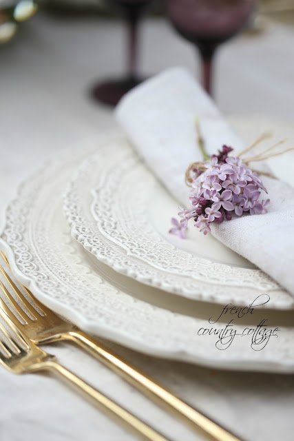 lilac with napkin on lace dishes