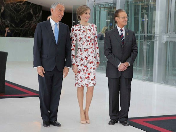 Uterque bag, Queen Letizia wore Zara wool coat in red, Carolina Herrera Floral Dress and Lodi Saray Pumps at European Conference in Porto