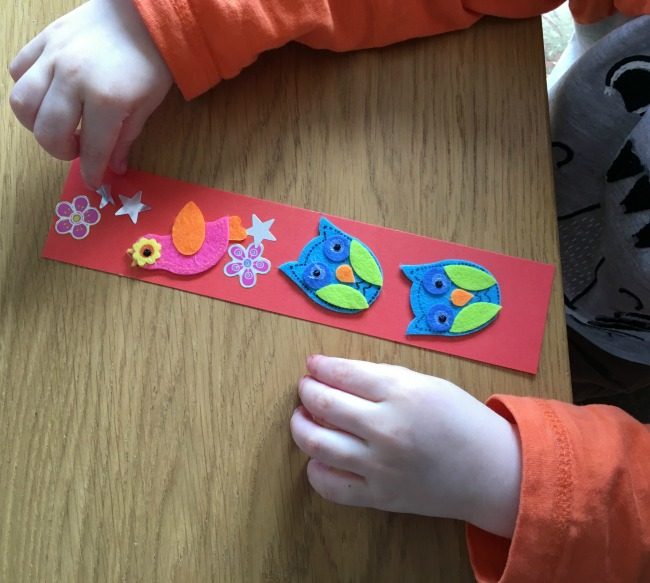 toddler placing stars on bookmark