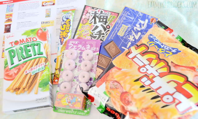 Details on the delicious Japanese snacks and candies in the Japanfunbox Mini box, including Glico Tomato Pretz, chocolate-covered Alfort biscuits, Calbee pizza potato chips, and more!