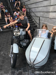 Kids riding Hagrid's motorcycle