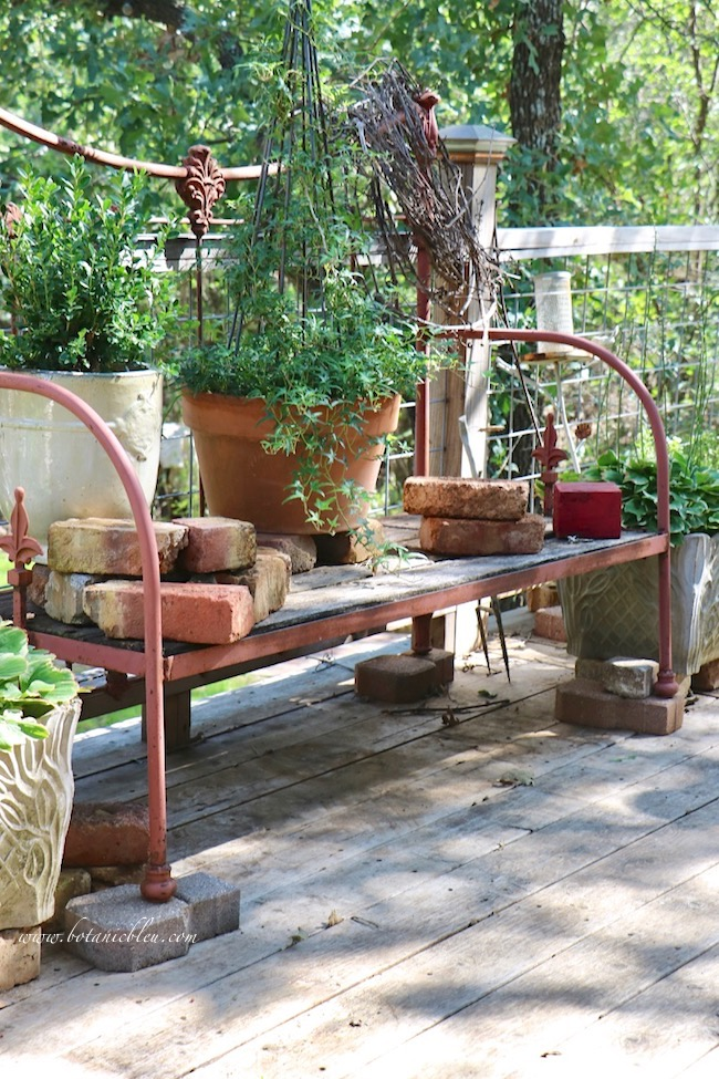 french country vintage garden bench from an iron bed found in an antique store