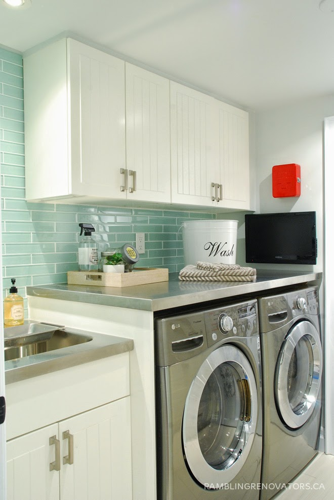 white laundry room ikea cabinetry stainless steel countertop