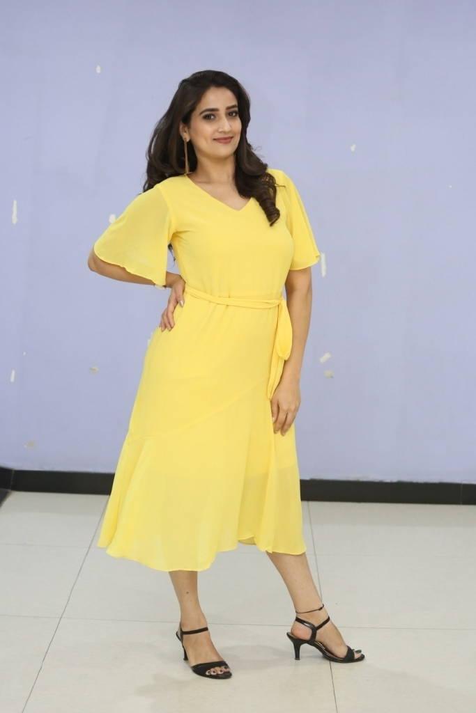 Indian Television Anchor Manjusha Hot Photo Shoot In Yellow Dress