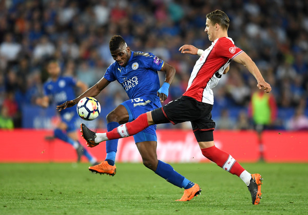 Kelechi Iheanacho of Leicester City is challenged by Jan Bednarek of Southampton during the Premier League match between Leicester City and Southampton at The King Power Stadium on April 19, 2018 in Leicester, England.
