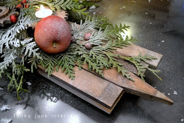 Rusty junk gear and funnel Christmas candle centrepiece