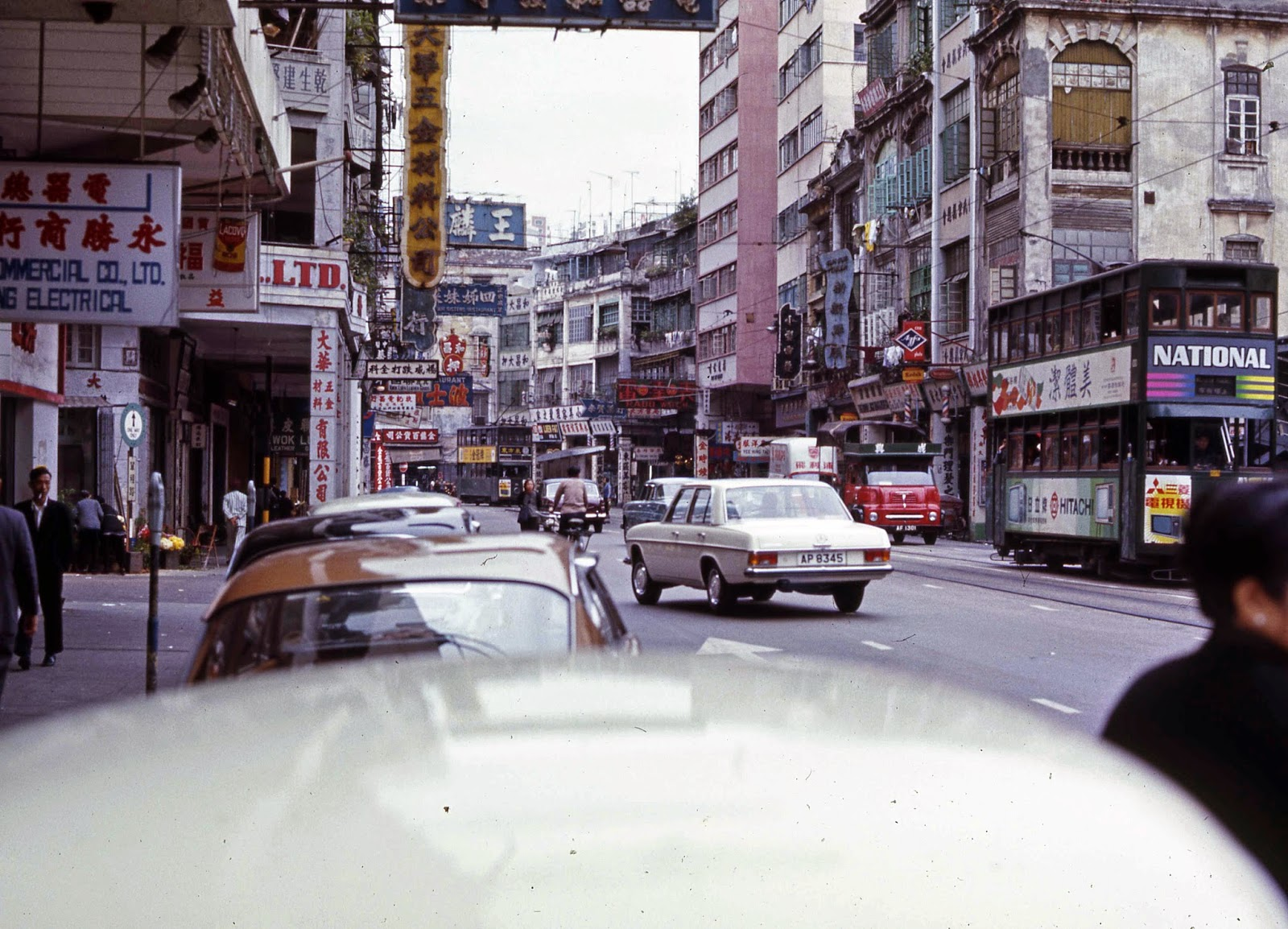 Busy Hong Kong street Mercedes and Double Decker buses Hitachi - Hong Kong 1969