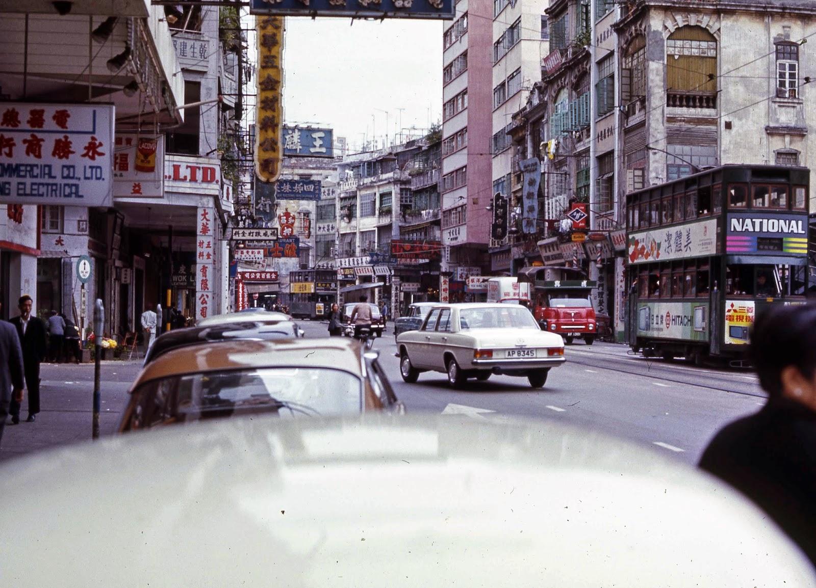 Busy Hong Kong street Mercedes and Double Decker buses Hitachi - Hong Kong 1969