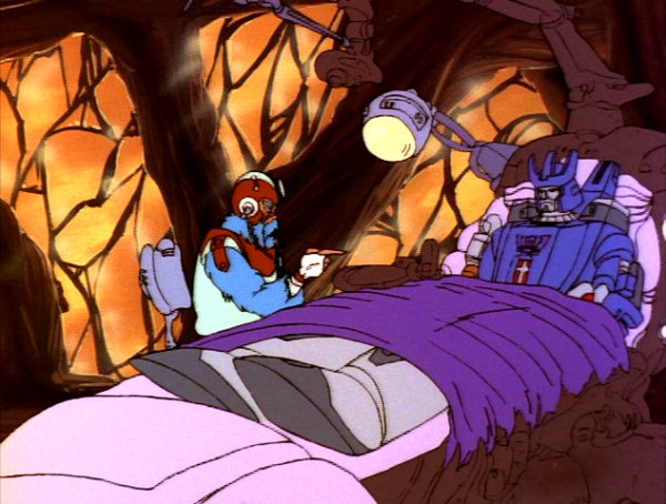 A scene from the Transfromers episode Webworld.  Galvatron is restrained to a therapist's couch, while a therapist tries to get Galvatron to open up.
