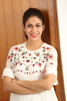 Lavanya Tripathi in Summer Style Spicy Short White Dress at her Interview  Exclusive 229.JPG