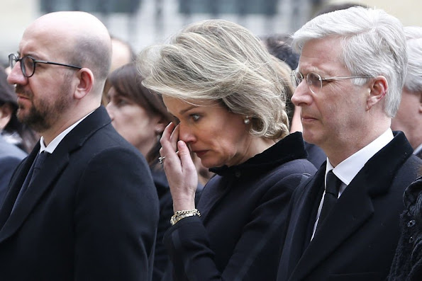 King Philippe of Belgium and Queen Mathilde of Belgium hold a minute of silence during