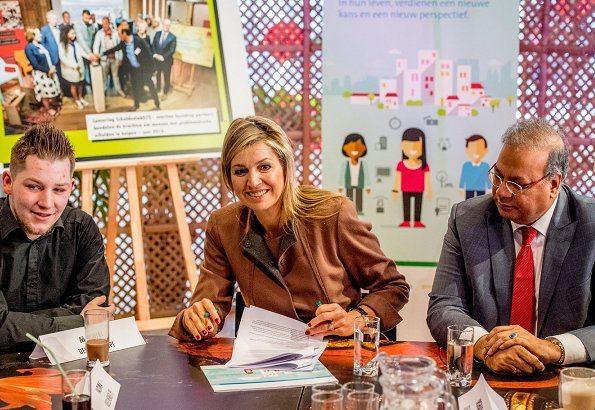 Queen Maxima met with people during a working visit to Schuldenlab070 (Debt Lab070) in The Hague.Natan dress