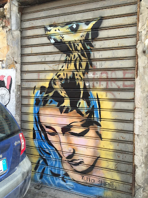 Palermo street art: dog and virgin mary