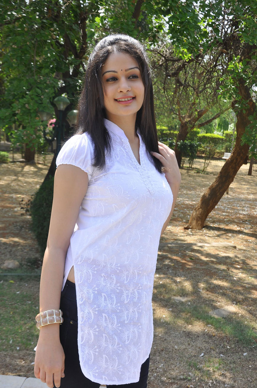 Band baaja heroine fair and pretty rupal in white kurta photos trying to show outdoor gallery