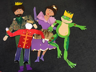 Four puppets featuring: a Prince, a lady, a soldier and a frog