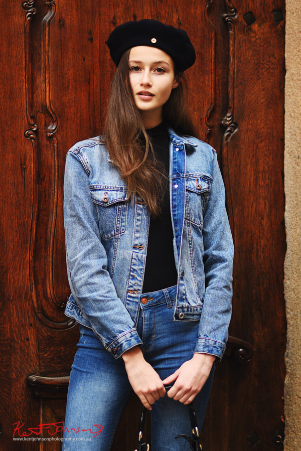 Double denim and an old oak door; Model Nikola Říhová photographed in Prague by Photographer Kent Johnson.