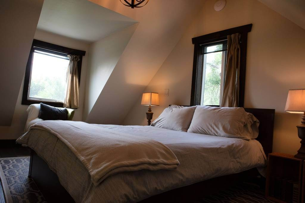 08-Master-Bedroom-Dormer-Windows-Trish-The-Potter-s-Retreat-Architecture-in-a-Tiny-House-www-designstack-co