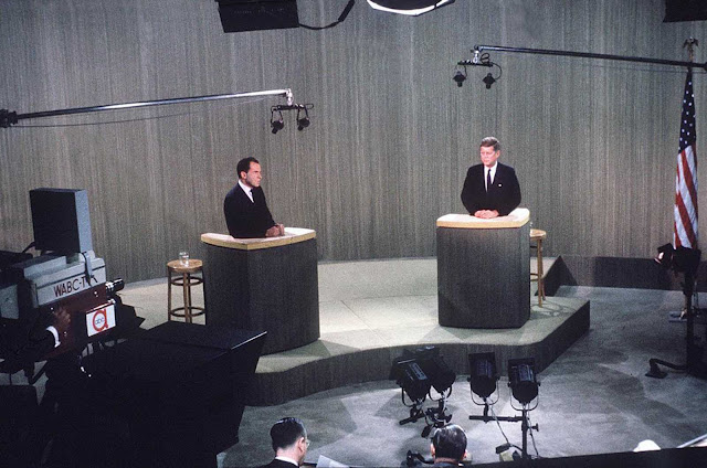 Republican Vice President Richard M. Nixon, left, debates Sen. John F. Kennedy, the Democratic presidential nominee, during a live broadcast from a New York television studio of their fourth presidential debate on October 21, 1960.