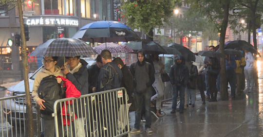 iPhone fans brave bad weather to get new phone, Apple Watch {Video}