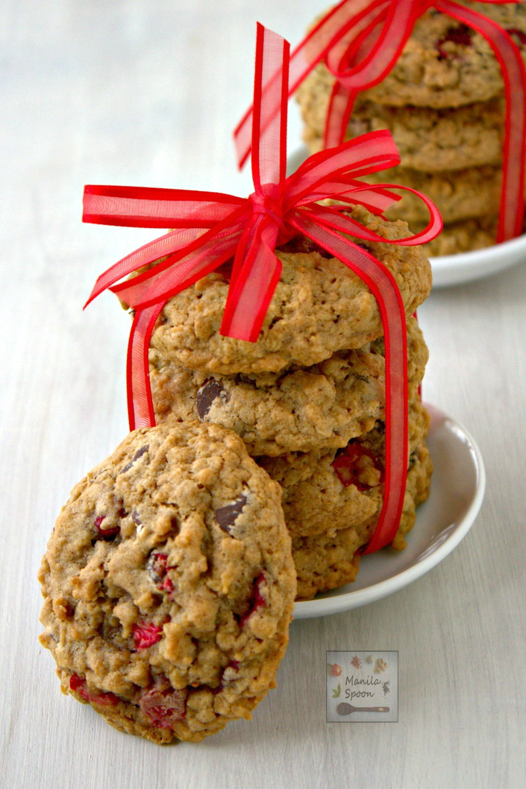 Chewy, moist and delicious cookies!! Cranberries give these yummy cookies a fresh tangy flavor which perfectly contrasts with chocolate and cinnamon spice. Perfect sweet treat for Thanksgiving, Christmas and New Year!