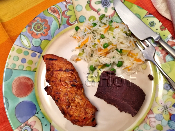 Lomito Adobado with Guatemalan Rice and Frijoles Volteados