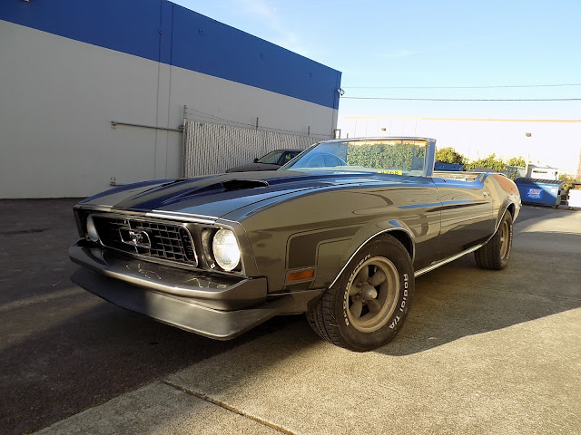 1973 Mustang with new front end, fender, door & quarter panel.