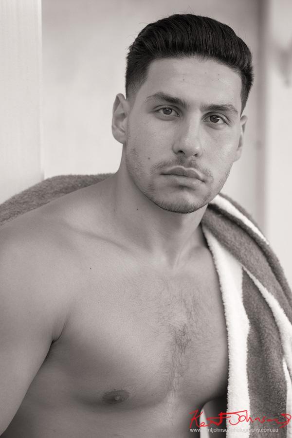 Headshot in black and white. Male modelling portfolio shot on Location in Sydney Australia by Kent Johnson.