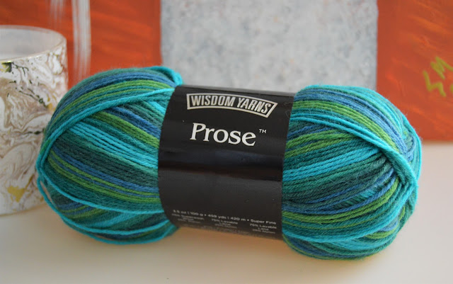 A watery blue and green self striping sock yarn.