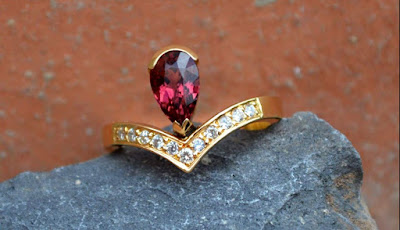 Tourmaline set in a 18 carat yellow gold engagement ring