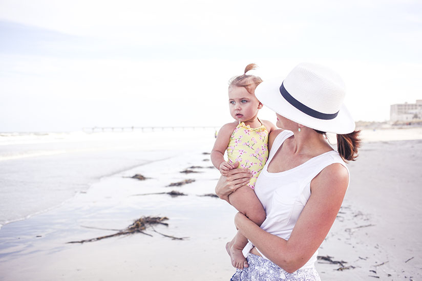 Amy West and daughter on the beach
