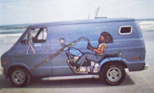 1970s day van with chopper motorcycle mural on the side.