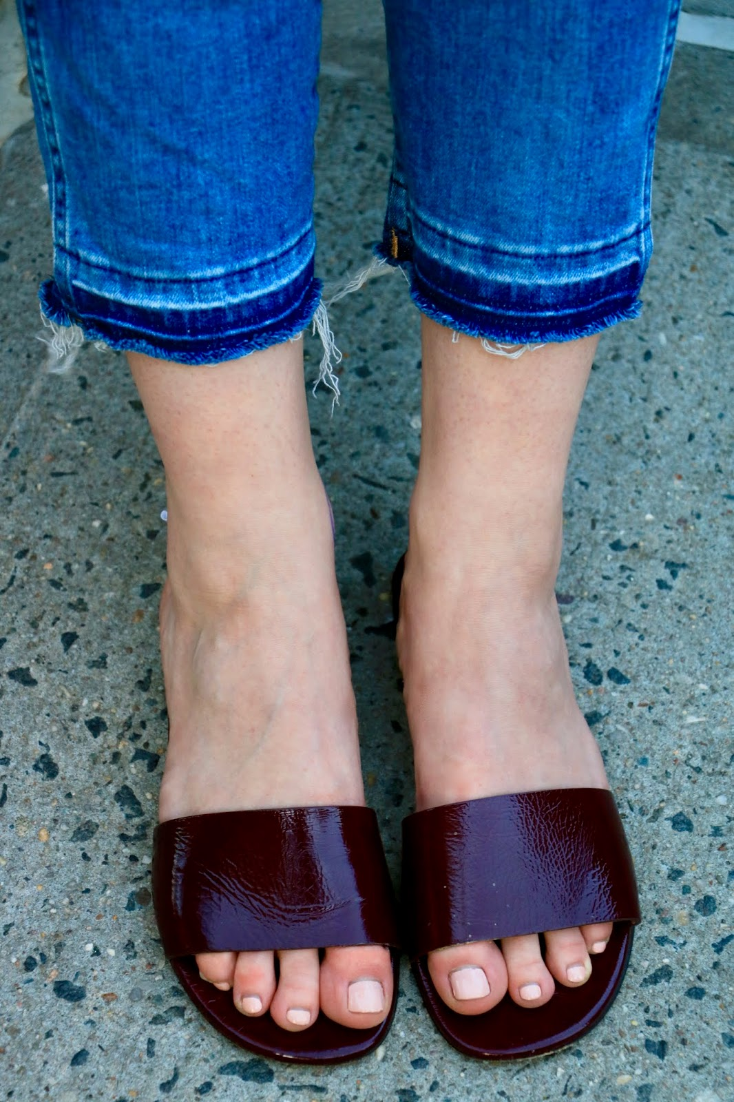 Nyc fashion blogger Kathleen Harper wearing leather slides by Theory.