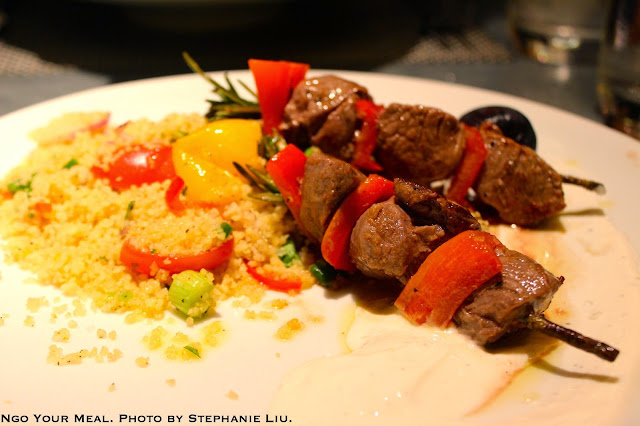 ROSEMARY LAMB: Grilled lamb on rosemary skewers, bell pepper, Greek yogurt, honey, couscous with fig, red onion, scallion, tomato – Koroneiki Olive Oil at Fig & Olive