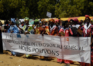 Women community leaders marched through the village holding a banner declaring 'We can fully abandon FGC in Senegal.'