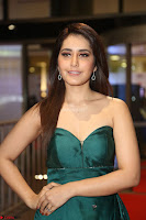 Raashi Khanna in Dark Green Sleeveless Strapless Deep neck Gown at 64th Jio Filmfare Awards South ~  Exclusive 145.JPG