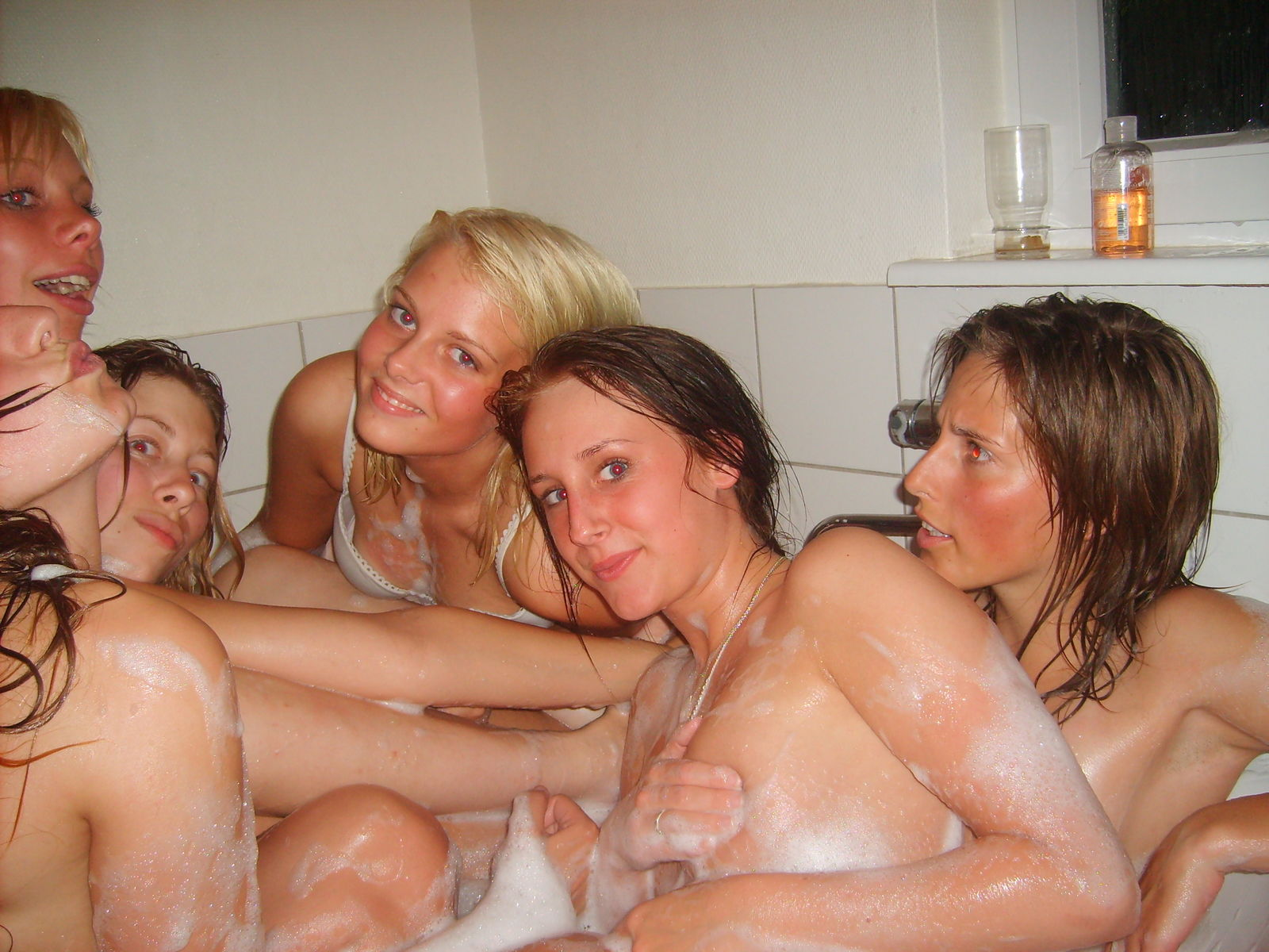 Lesbians Pose In The Bath For Sexy Photo Shoot