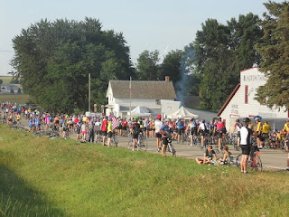 Thousands of cyclists passing through a small Iowa town.
