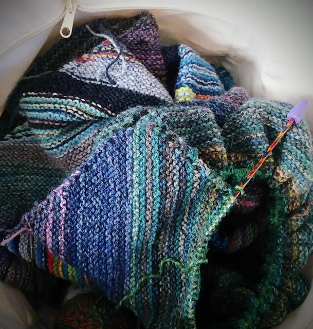 Blanket knit with Patons Kroy Socks yarn.  Diagonally striped knit blanket.